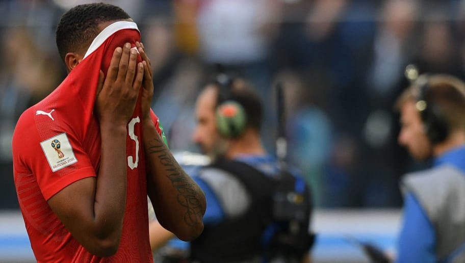 Switzerland's defender Manuel Akanji reacts after the team lost the Russia 2018 World Cup round of 16 football match between Sweden and Switzerland at the Saint Petersburg Stadium in Saint Petersburg on July 3, 2018. (Photo by OLGA MALTSEVA / AFP) / RESTRICTED TO EDITORIAL USE - NO MOBILE PUSH ALERTS/DOWNLOADS        (Photo credit should read OLGA MALTSEVA/AFP/Getty Images)