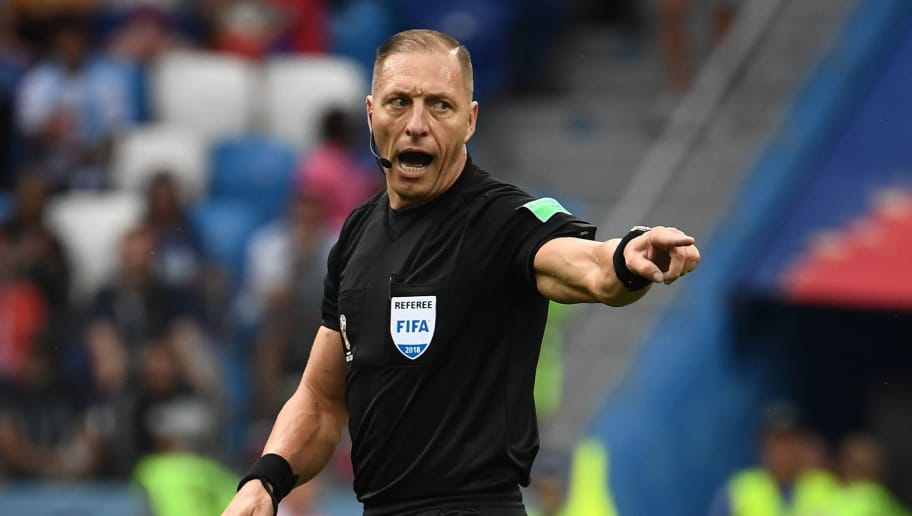 Argentininian referee Nestor Pitana gestures during the Russia 2018 World Cup quarter-final football match between Uruguay and France at the Nizhny Novgorod Stadium in Nizhny Novgorod on July 6, 2018. (Photo by FRANCK FIFE / AFP) / RESTRICTED TO EDITORIAL USE - NO MOBILE PUSH ALERTS/DOWNLOADS        (Photo credit should read FRANCK FIFE/AFP/Getty Images)