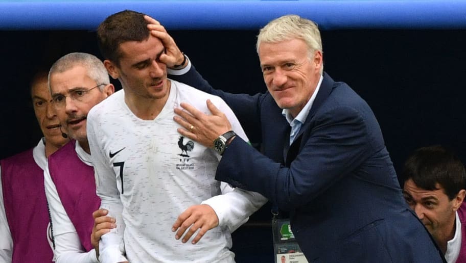 France's coach Didier Deschamps (R) speaks with France's forward Antoine Griezmann during the Russia 2018 World Cup quarter-final football match between Uruguay and France at the Nizhny Novgorod Stadium in Nizhny Novgorod on July 6, 2018. (Photo by Dimitar DILKOFF / AFP)        (Photo credit should read DIMITAR DILKOFF/AFP/Getty Images)