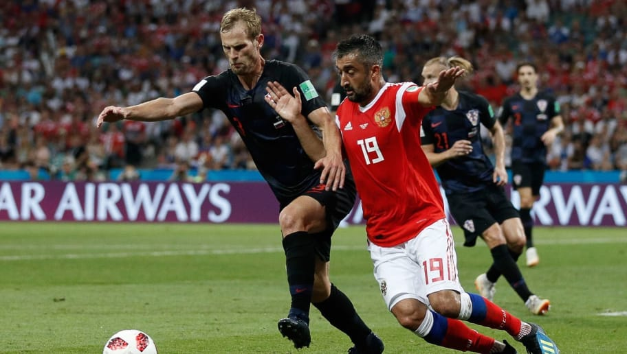 Croatia's defender Ivan Strinic (L) vies for the ball with Russia's midfielder Alexander Samedov during the Russia 2018 World Cup quarter-final football match between Russia and Croatia at the Fisht Stadium in Sochi on July 7, 2018. (Photo by Adrian DENNIS / AFP) / RESTRICTED TO EDITORIAL USE - NO MOBILE PUSH ALERTS/DOWNLOADS        (Photo credit should read ADRIAN DENNIS/AFP/Getty Images)