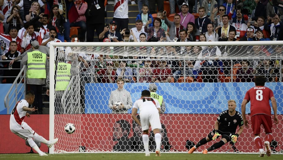 Peru's midfielder Christian Cueva (L) fails his penalty kick during the Russia 2018 World Cup Group C football match between Peru and Denmark at the Mordovia Arena in Saransk on June 16, 2018. (Photo by Filippo MONTEFORTE / AFP) / RESTRICTED TO EDITORIAL USE - NO MOBILE PUSH ALERTS/DOWNLOADS        (Photo credit should read FILIPPO MONTEFORTE/AFP/Getty Images)