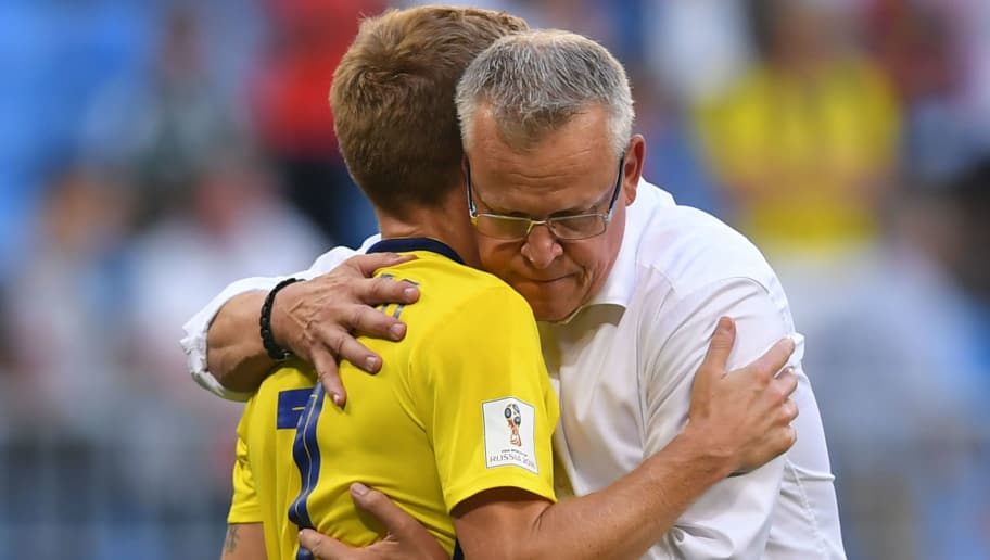 Sweden's midfielder Sebastian Larsson is embraced by Sweden's coach Janne Andersson after the Russia 2018 World Cup quarter-final football match between Sweden and England at the Samara Arena in Samara on July 7, 2018. - England beat Sweden 2-0 to reach World Cup semi-finals. (Photo by Manan VATSYAYANA / AFP) / RESTRICTED TO EDITORIAL USE - NO MOBILE PUSH ALERTS/DOWNLOADS        (Photo credit should read MANAN VATSYAYANA/AFP/Getty Images)