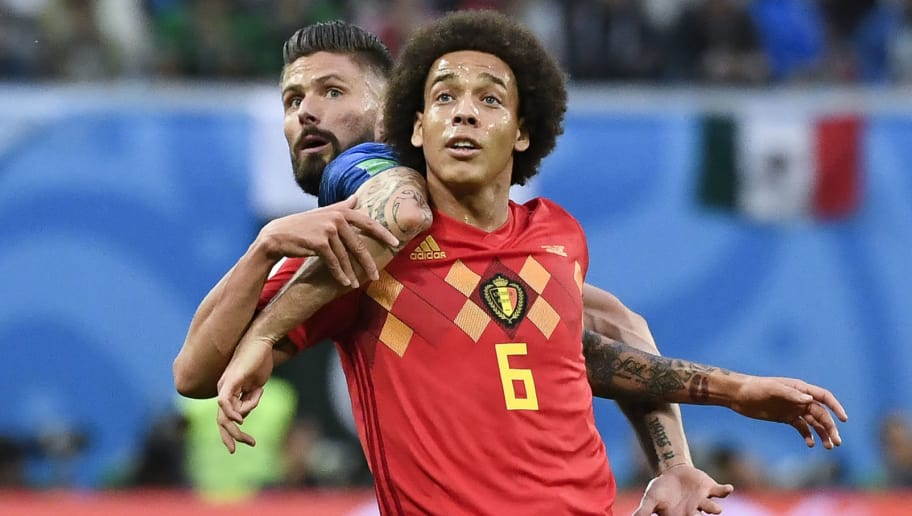 Belgium's midfielder Axel Witsel (R) vies with France's forward Olivier Giroud during the Russia 2018 World Cup semi-final football match between France and Belgium at the Saint Petersburg Stadium in Saint Petersburg on July 10, 2018. (Photo by CHRISTOPHE SIMON / AFP) / RESTRICTED TO EDITORIAL USE - NO MOBILE PUSH ALERTS/DOWNLOADS        (Photo credit should read CHRISTOPHE SIMON/AFP/Getty Images)