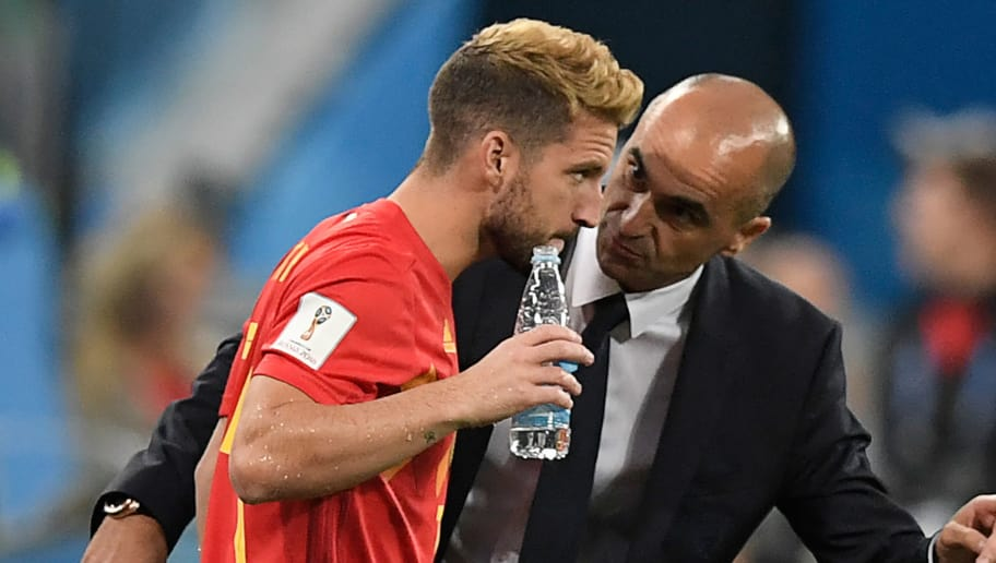 Belgium's coach Roberto Martinez (R) speaks with Belgium's forward Dries Mertens (L) ahead of being brought on during the Russia 2018 World Cup semi-final football match between France and Belgium at the Saint Petersburg Stadium in Saint Petersburg on July 10, 2018. (Photo by GABRIEL BOUYS / AFP) / RESTRICTED TO EDITORIAL USE - NO MOBILE PUSH ALERTS/DOWNLOADS        (Photo credit should read GABRIEL BOUYS/AFP/Getty Images)