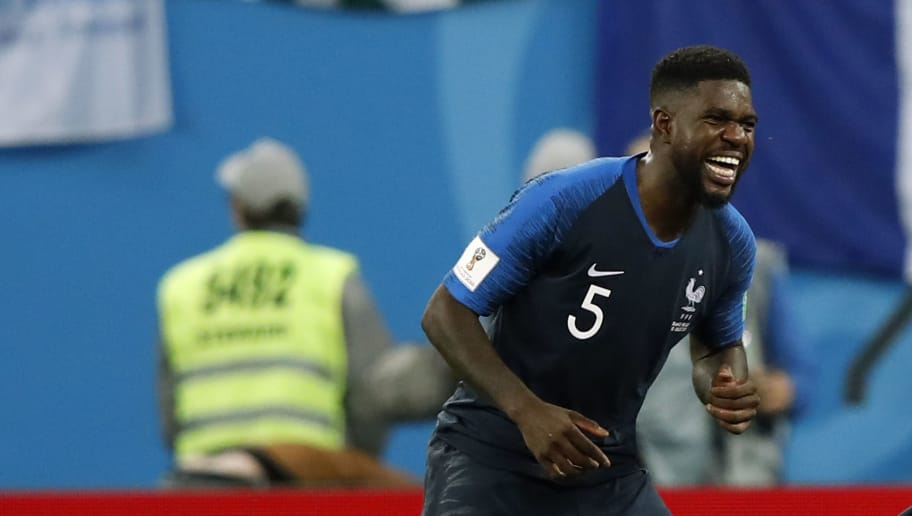 France's defender Samuel Umtiti celebrates their victory at the end of the Russia 2018 World Cup semi-final football match between France and Belgium at the Saint Petersburg Stadium in Saint Petersburg on July 10, 2018. (Photo by Odd ANDERSEN / AFP) / RESTRICTED TO EDITORIAL USE - NO MOBILE PUSH ALERTS/DOWNLOADS        (Photo credit should read ODD ANDERSEN/AFP/Getty Images)