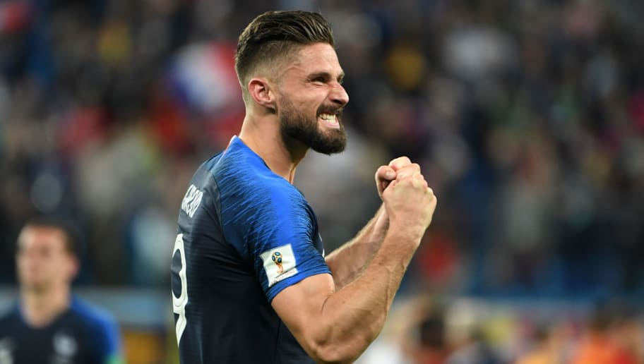 France's forward Olivier Giroud celebrates the team's victory in the Russia 2018 World Cup semi-final football match between France and Belgium at the Saint Petersburg Stadium in Saint Petersburg on July 10, 2018. (Photo by Paul ELLIS / AFP) / RESTRICTED TO EDITORIAL USE - NO MOBILE PUSH ALERTS/DOWNLOADS        (Photo credit should read PAUL ELLIS/AFP/Getty Images)