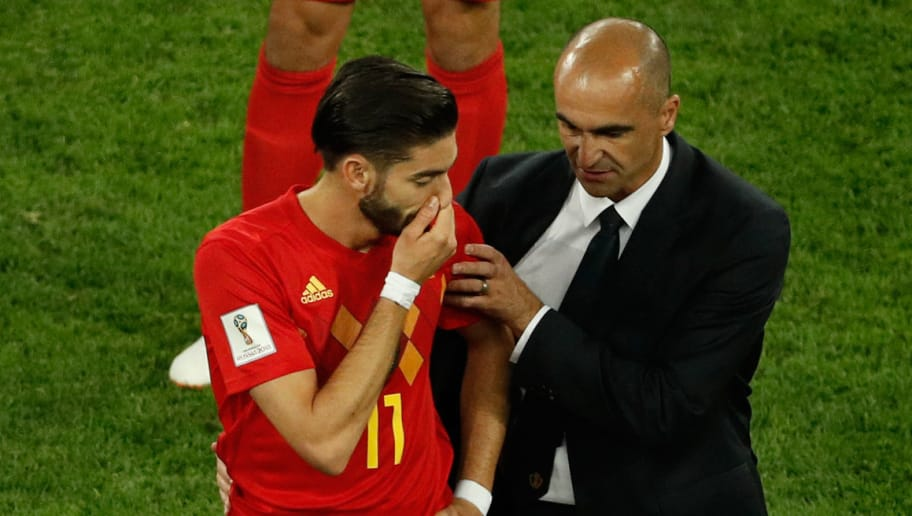 Belgium's midfielder Yannick Ferreira-Carrasco (L) is consoled by Belgium's coach Roberto Martinez (R) at the end of the Russia 2018 World Cup semi-final football match between France and Belgium at the Saint Petersburg Stadium in Saint Petersburg on July 10, 2018. (Photo by Adrian DENNIS / AFP) / RESTRICTED TO EDITORIAL USE - NO MOBILE PUSH ALERTS/DOWNLOADS        (Photo credit should read ADRIAN DENNIS/AFP/Getty Images)
