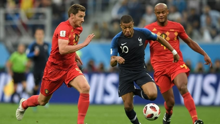 France's forward Kylian Mbappe (C) runs with the ball as he is marked by Belgium's defender Jan Vertonghen (L) and Belgium's defender Vincent Kompany during the Russia 2018 World Cup semi-final football match between France and Belgium at the Saint Petersburg Stadium in Saint Petersburg on July 10, 2018. (Photo by GABRIEL BOUYS / AFP) / RESTRICTED TO EDITORIAL USE - NO MOBILE PUSH ALERTS/DOWNLOADS        (Photo credit should read GABRIEL BOUYS/AFP/Getty Images)