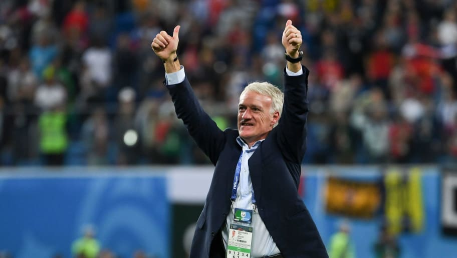 France's coach Didier Deschamps celebrates the team's victory in the Russia 2018 World Cup semi-final football match between France and Belgium at the Saint Petersburg Stadium in Saint Petersburg on July 10, 2018. (Photo by Paul ELLIS / AFP) / RESTRICTED TO EDITORIAL USE - NO MOBILE PUSH ALERTS/DOWNLOADS        (Photo credit should read PAUL ELLIS/AFP/Getty Images)