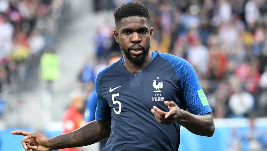 France's defender Samuel Umtiti celebrates scoring the opening goal during the Russia 2018 World Cup semi-final football match between France and Belgium at the Saint Petersburg Stadium in Saint Petersburg on July 10, 2018. (Photo by CHRISTOPHE SIMON / AFP) / RESTRICTED TO EDITORIAL USE - NO MOBILE PUSH ALERTS/DOWNLOADS        (Photo credit should read CHRISTOPHE SIMON/AFP/Getty Images)