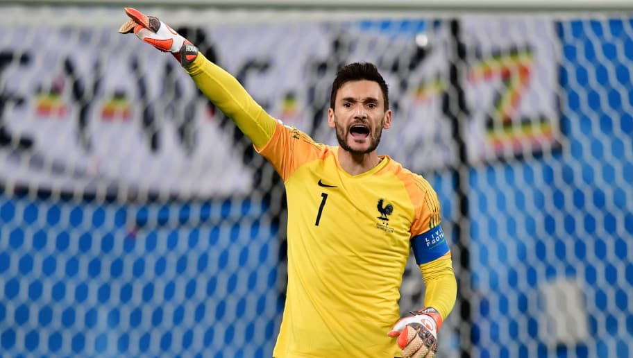 France's goalkeeper Hugo Lloris speaks with his teammates during the Russia 2018 World Cup semi-final football match between France and Belgium at the Saint Petersburg Stadium in Saint Petersburg on July 10, 2018. (Photo by Giuseppe CACACE / AFP) / RESTRICTED TO EDITORIAL USE - NO MOBILE PUSH ALERTS/DOWNLOADS        (Photo credit should read GIUSEPPE CACACE/AFP/Getty Images)