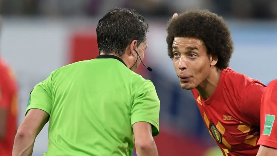 Uruguayan referee Andres Cunha (L) speaks with Belgium's midfielder Axel Witsel (C) during the Russia 2018 World Cup semi-final football match between France and Belgium at the Saint Petersburg Stadium in Saint Petersburg on July 10, 2018. (Photo by GABRIEL BOUYS / AFP) / RESTRICTED TO EDITORIAL USE - NO MOBILE PUSH ALERTS/DOWNLOADS        (Photo credit should read GABRIEL BOUYS/AFP/Getty Images)