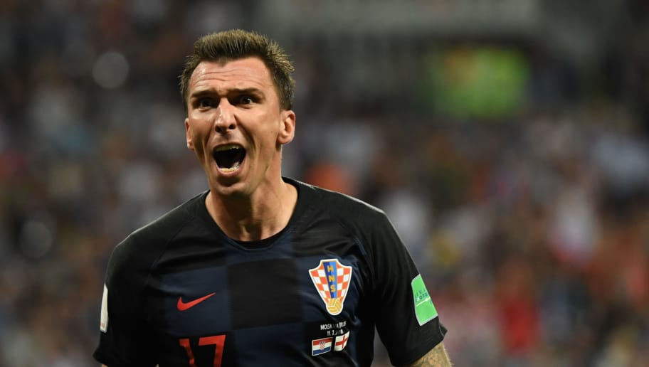 Croatia's forward Mario Mandzukic celebrates after scoring his team's second goal during the Russia 2018 World Cup semi-final football match between Croatia and England at the Luzhniki Stadium in Moscow on July 11, 2018. (Photo by YURI CORTEZ / AFP) / RESTRICTED TO EDITORIAL USE - NO MOBILE PUSH ALERTS/DOWNLOADS        (Photo credit should read YURI CORTEZ/AFP/Getty Images)