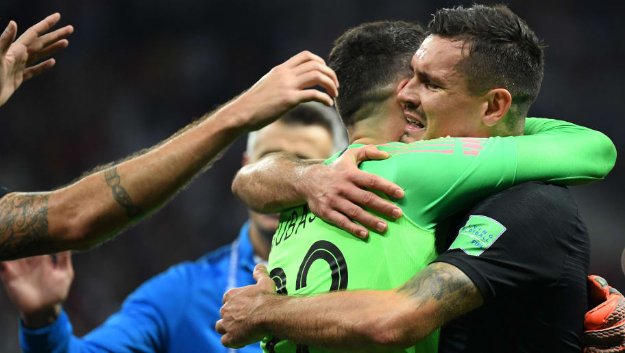 Croatia's defender Dejan Lovren (R) and Croatia's goalkeeper Danijel Subasic celebrate at the end of the Russia 2018 World Cup semi-final football match between Croatia and England at the Luzhniki Stadium in Moscow on July 11, 2018. (Photo by YURI CORTEZ / AFP) / RESTRICTED TO EDITORIAL USE - NO MOBILE PUSH ALERTS/DOWNLOADS        (Photo credit should read YURI CORTEZ/AFP/Getty Images)
