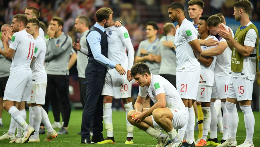 England's defender Harry Maguire (front C) reacts along with teammates at the end of the Russia 2018 World Cup semi-final football match between Croatia and England at the Luzhniki Stadium in Moscow on July 11, 2018. (Photo by Kirill KUDRYAVTSEV / AFP) / RESTRICTED TO EDITORIAL USE - NO MOBILE PUSH ALERTS/DOWNLOADS        (Photo credit should read KIRILL KUDRYAVTSEV/AFP/Getty Images)