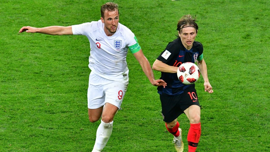 England's forward Harry Kane (L) vies with Croatia's midfielder Luka Modric (R) during the Russia 2018 World Cup semi-final football match between Croatia and England at the Luzhniki Stadium in Moscow on July 11, 2018. (Photo by Mladen ANTONOV / AFP) / RESTRICTED TO EDITORIAL USE - NO MOBILE PUSH ALERTS/DOWNLOADS        (Photo credit should read MLADEN ANTONOV/AFP/Getty Images)