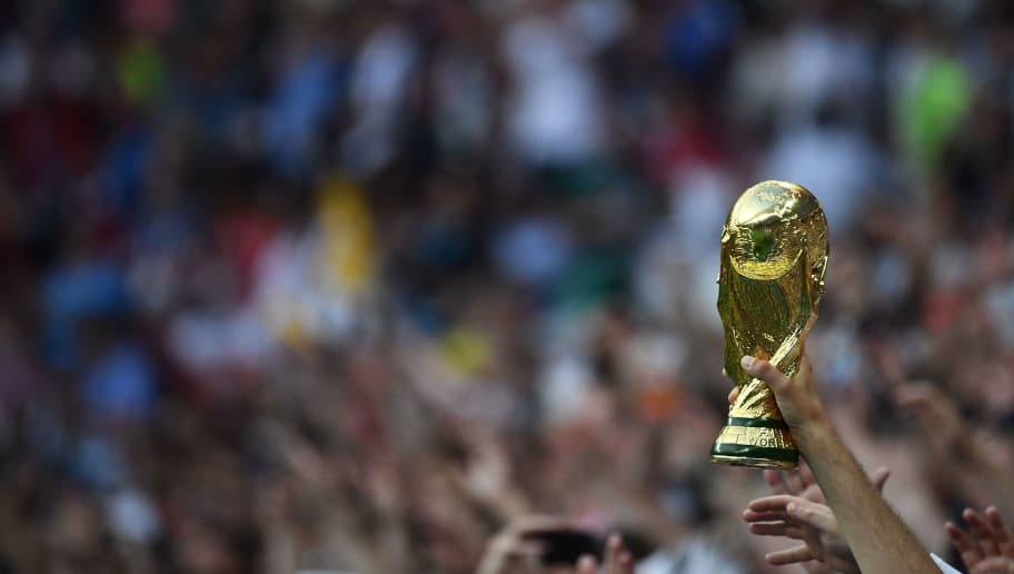 An England supporter carries a replica of the World Cup trophy during the Russia 2018 World Cup semi-final football match between Croatia and England at the Luzhniki Stadium in Moscow on July 11, 2018. (Photo by FRANCK FIFE / AFP) / RESTRICTED TO EDITORIAL USE - NO MOBILE PUSH ALERTS/DOWNLOADS        (Photo credit should read FRANCK FIFE/AFP/Getty Images)
