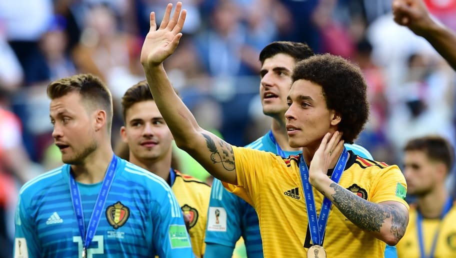 Belgium's midfielder Axel Witsel (R) and Belgium's goalkeeper Simon Mignolet (L) celebrate their victory after their Russia 2018 World Cup play-off for third place football match between Belgium and England at the Saint Petersburg Stadium in Saint Petersburg on July 14, 2018. (Photo by Giuseppe CACACE / AFP) / RESTRICTED TO EDITORIAL USE - NO MOBILE PUSH ALERTS/DOWNLOADS        (Photo credit should read GIUSEPPE CACACE/AFP/Getty Images)