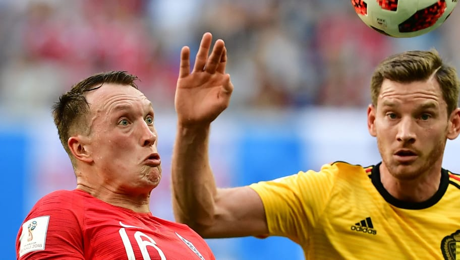 England's defender Phil Jones (L) eyes the ball with Belgium's defender Jan Vertonghen during their Russia 2018 World Cup play-off for third place football match between Belgium and England at the Saint Petersburg Stadium in Saint Petersburg on July 14, 2018. (Photo by Giuseppe CACACE / AFP) / RESTRICTED TO EDITORIAL USE - NO MOBILE PUSH ALERTS/DOWNLOADS        (Photo credit should read GIUSEPPE CACACE/AFP/Getty Images)