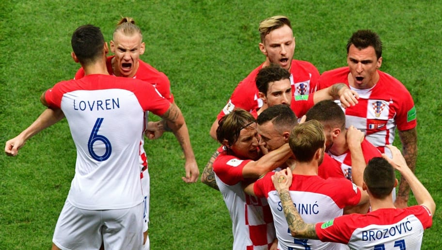 Croatia's forward Ivan Perisic celebrates with his teammates after scoring the 1-1 equalizer during the Russia 2018 World Cup final football match between France and Croatia at the Luzhniki Stadium in Moscow on July 15, 2018. (Photo by Mladen ANTONOV / AFP) / RESTRICTED TO EDITORIAL USE - NO MOBILE PUSH ALERTS/DOWNLOADS        (Photo credit should read MLADEN ANTONOV/AFP/Getty Images)