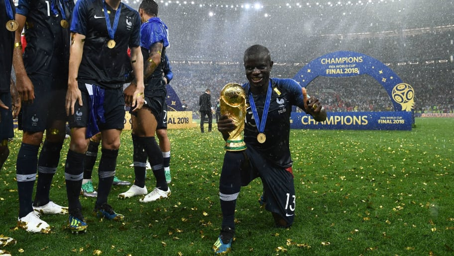 France's midfielder N'Golo Kante poses with the World Cup trophy during the trophy ceremony at the end of the Russia 2018 World Cup final football match between France and Croatia at the Luzhniki Stadium in Moscow on July 15, 2018. (Photo by FRANCK FIFE / AFP) / RESTRICTED TO EDITORIAL USE - NO MOBILE PUSH ALERTS/DOWNLOADS        (Photo credit should read FRANCK FIFE/AFP/Getty Images)