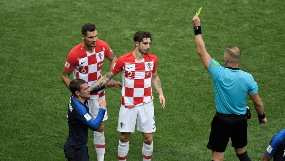 Argentinian referee Nestor Pitana gives a yellow card to Croatia's defender Sime Vrsaljko (C) during the Russia 2018 World Cup final football match between France and Croatia at the Luzhniki Stadium in Moscow on July 15, 2018. (Photo by GABRIEL BOUYS / AFP) / RESTRICTED TO EDITORIAL USE - NO MOBILE PUSH ALERTS/DOWNLOADS        (Photo credit should read GABRIEL BOUYS/AFP/Getty Images)