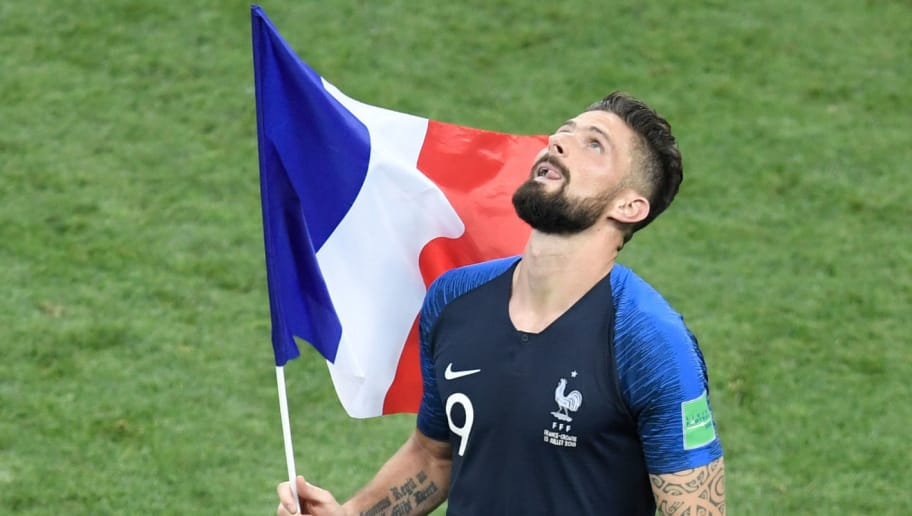 France's forward Olivier Giroud runs with the French national flag as he celebrates at the end of the Russia 2018 World Cup final football match between France and Croatia at the Luzhniki Stadium in Moscow on July 15, 2018. (Photo by GABRIEL BOUYS / AFP) / RESTRICTED TO EDITORIAL USE - NO MOBILE PUSH ALERTS/DOWNLOADS        (Photo credit should read GABRIEL BOUYS/AFP/Getty Images)