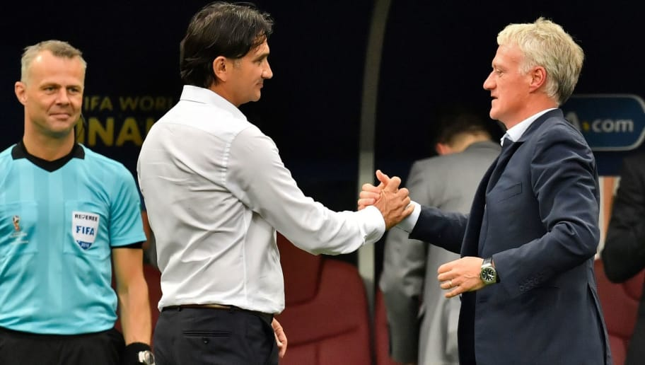 France's coach Didier Deschamps (R) is congratulated by Croatia's coach Zlatko Dalic (C) at the end of the Russia 2018 World Cup final football match between France and Croatia at the Luzhniki Stadium in Moscow on July 15, 2018. (Photo by CHRISTOPHE SIMON / AFP) / RESTRICTED TO EDITORIAL USE - NO MOBILE PUSH ALERTS/DOWNLOADS        (Photo credit should read CHRISTOPHE SIMON/AFP/Getty Images)