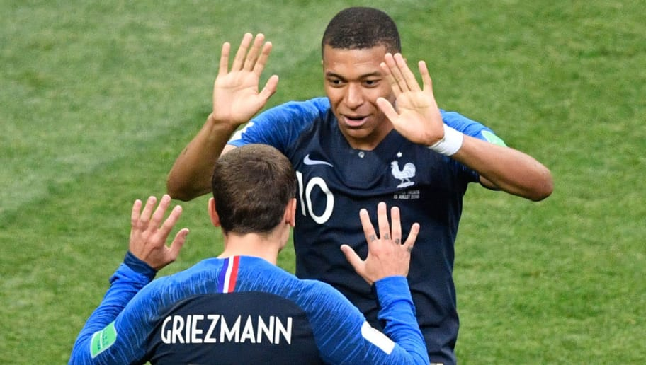 France's forward Kylian Mbappe (rear) celebrates with France's forward Antoine Griezmann after scoring a goal during the Russia 2018 World Cup final football match between France and Croatia at the Luzhniki Stadium in Moscow on July 15, 2018. (Photo by Alexander NEMENOV / AFP) / RESTRICTED TO EDITORIAL USE - NO MOBILE PUSH ALERTS/DOWNLOADS        (Photo credit should read ALEXANDER NEMENOV/AFP/Getty Images)