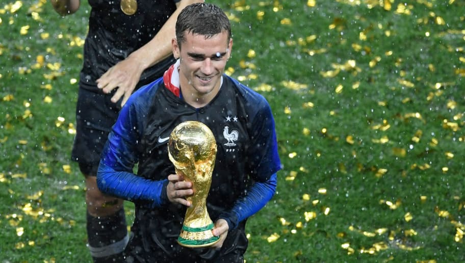 France's forward Antoine Griezmann holds the trophy as he celebrates during the trophy ceremony after winning the Russia 2018 World Cup final football match between France and Croatia at the Luzhniki Stadium in Moscow on July 15, 2018. (Photo by GABRIEL BOUYS / AFP) / RESTRICTED TO EDITORIAL USE - NO MOBILE PUSH ALERTS/DOWNLOADS        (Photo credit should read GABRIEL BOUYS/AFP/Getty Images)