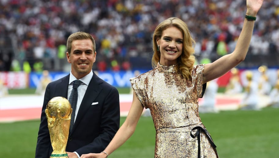 Germany's former captain Philipp Lahm (L) and Russian model Natalia Vodianova pose with the World Cup trophy during the closing ceremony of the Russia 2018 World Cup ahead of the final football match between France and Croatia at the Luzhniki Stadium in Moscow on July 15, 2018. (Photo by FRANCK FIFE / AFP) / RESTRICTED TO EDITORIAL USE - NO MOBILE PUSH ALERTS/DOWNLOADS        (Photo credit should read FRANCK FIFE/AFP/Getty Images)