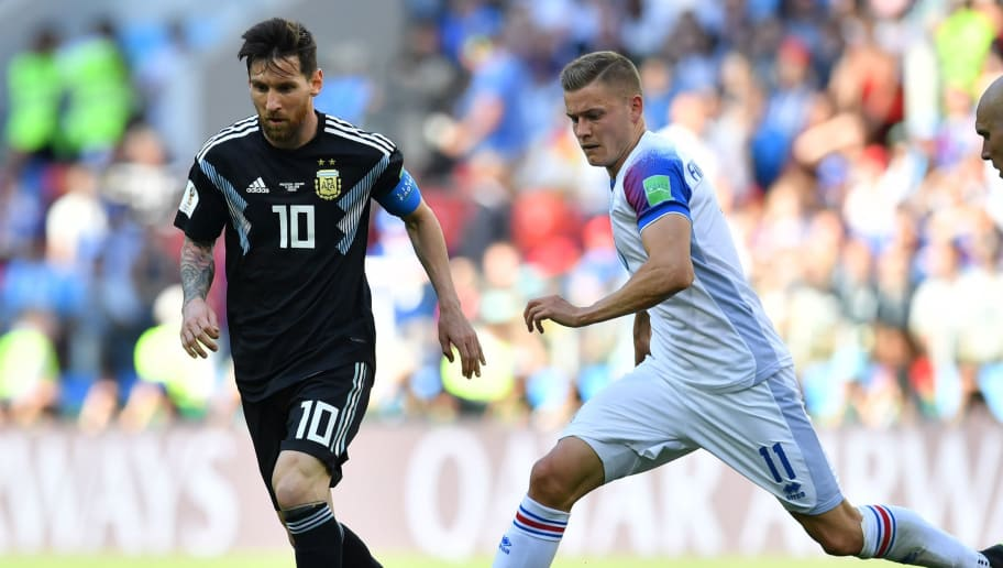 Argentina's forward Lionel Messi challenges Iceland's forward Alfred Finnbogason (R) during the Russia 2018 World Cup Group D football match between Argentina and Iceland at the Spartak Stadium in Moscow on June 16, 2018. (Photo by Yuri CORTEZ / AFP) / RESTRICTED TO EDITORIAL USE - NO MOBILE PUSH ALERTS/DOWNLOADS        (Photo credit should read YURI CORTEZ/AFP/Getty Images)