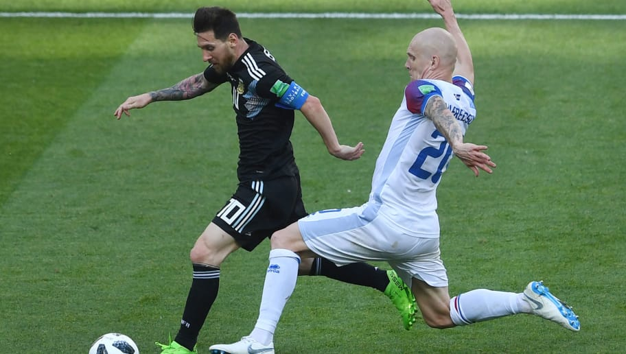 Argentina's forward Lionel Messi (L) vies with Iceland's midfielder Emil Hallfredsson during the Russia 2018 World Cup Group D football match between Argentina and Iceland at the Spartak Stadium in Moscow on June 16, 2018. (Photo by Francisco LEONG / AFP) / RESTRICTED TO EDITORIAL USE - NO MOBILE PUSH ALERTS/DOWNLOADS        (Photo credit should read FRANCISCO LEONG/AFP/Getty Images)