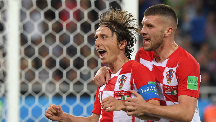 Croatia's midfielder Luka Modric (L) celebrates scoring a penalty with his teammate forward Ante Rebic during the Russia 2018 World Cup Group D football match between Croatia and Nigeria at the Kaliningrad Stadium in Kaliningrad on June 16, 2018. (Photo by Patrick HERTZOG / AFP) / RESTRICTED TO EDITORIAL USE - NO MOBILE PUSH ALERTS/DOWNLOADS        (Photo credit should read PATRICK HERTZOG/AFP/Getty Images)