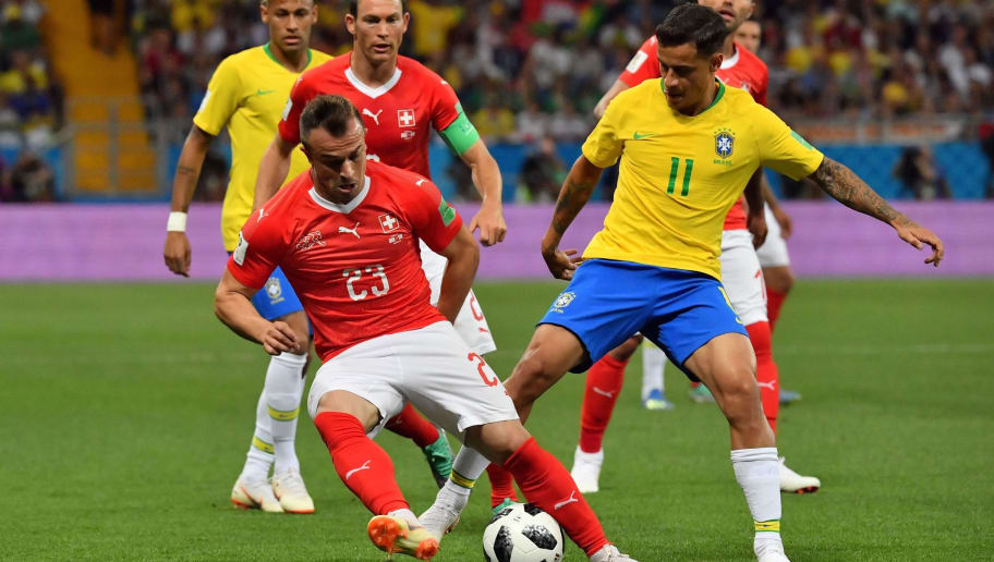 Switzerland's forward Xherdan Shaqiri (L) and Brazil's forward Philippe Coutinho compete for the ball during the Russia 2018 World Cup Group E football match between Brazil and Switzerland at the Rostov Arena in Rostov-On-Don on June 17, 2018. (Photo by Pascal GUYOT / AFP) / RESTRICTED TO EDITORIAL USE - NO MOBILE PUSH ALERTS/DOWNLOADS        (Photo credit should read PASCAL GUYOT/AFP/Getty Images)