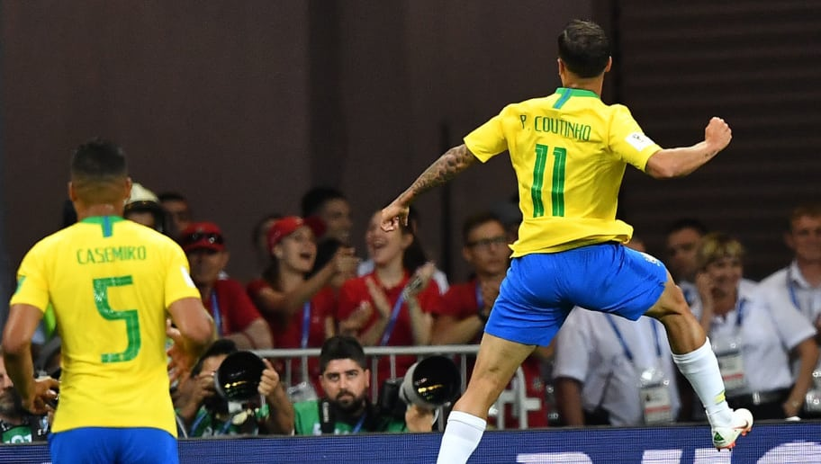 Brazil's forward Philippe Coutinho (R) celebrates his goal during the Russia 2018 World Cup Group E football match between Brazil and Switzerland at the Rostov Arena in Rostov-On-Don on June 17, 2018. (Photo by JOE KLAMAR / AFP) / RESTRICTED TO EDITORIAL USE - NO MOBILE PUSH ALERTS/DOWNLOADS        (Photo credit should read JOE KLAMAR/AFP/Getty Images)