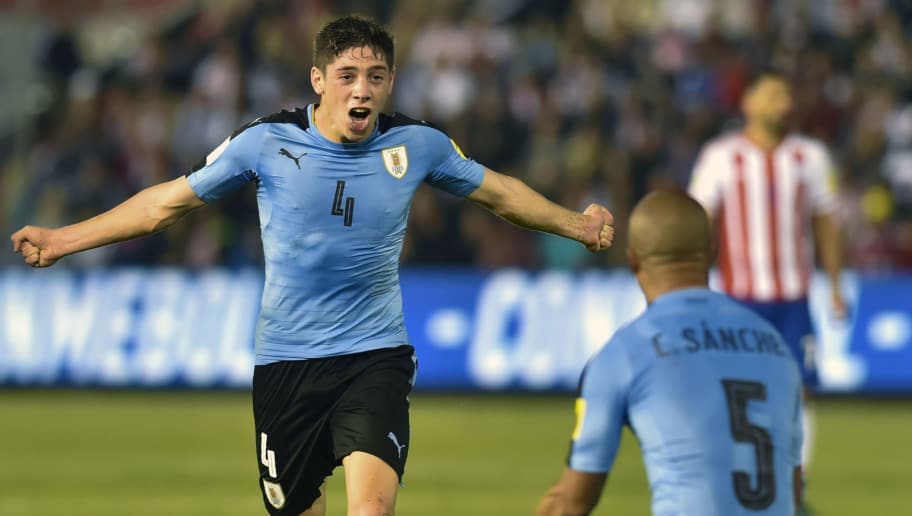 Uruguay's Federico Valverde celebrates with teammate Carlos Sanchez (R) after scoring against Paraguay during their 2018 World Cup football qualifier match in Asuncion, on September 5, 2017. / AFP PHOTO / DANIEL  DUARTE        (Photo credit should read DANIEL  DUARTE/AFP/Getty Images)