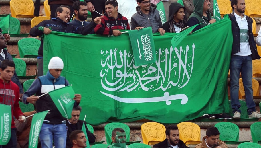 Fans of the Saudi national team wave the national flag during the AFC qualifying football match for the 2018 FIFA World Cup between Palestine and Saudi Arabia on November 9, 2015, at the Amman International Stadium in the Jordanian capital. AFP PHOTO / KHALIL MAZRAAWI        (Photo credit should read KHALIL MAZRAAWI/AFP/Getty Images)