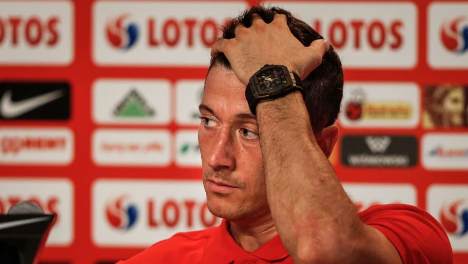 Poland's forward Robert Lewandowski reacts during  a press conference  at the Sputnik Sports Ground in Sochi on June 25, 2018 at the Russia 2018 FIFA World Cup football tournament. (Photo by Adrian DENNIS / AFP)        (Photo credit should read ADRIAN DENNIS/AFP/Getty Images)