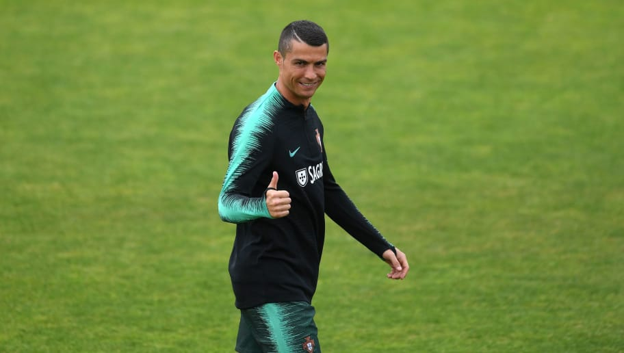 Portuguese forward Cristiano Ronaldo gestures during a training session on June 4, 2018 at Cidade do Futebol in Oeiras during the Portugal national football team's training camp in preparation for the Russia World Championship 2018. (Photo by FRANCISCO LEONG / AFP)        (Photo credit should read FRANCISCO LEONG/AFP/Getty Images)