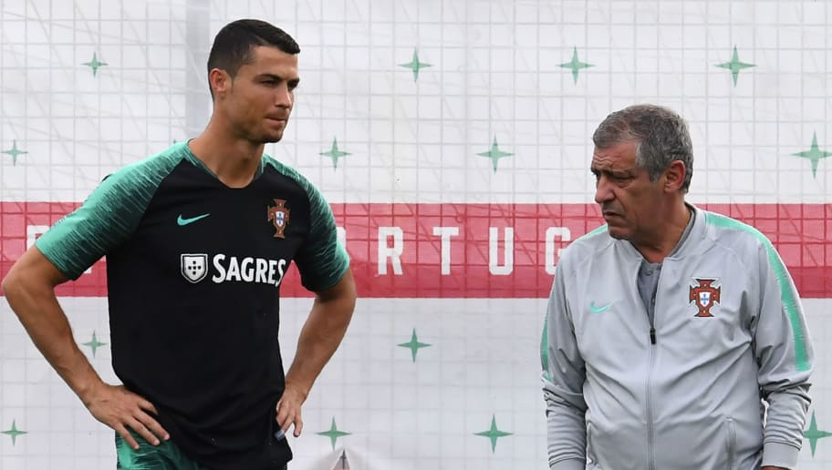 Portugal's forward Cristiano Ronaldo (L) talks to coach Fernando Santos during a training session at the team's base in Kratovo, outside Moscow, on June 21, 2018 during the Russia 2018 World Cup football tournament. (Photo by Francisco LEONG / AFP)        (Photo credit should read FRANCISCO LEONG/AFP/Getty Images)