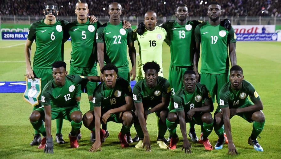 Nigeria's (top L-R) Leon Balogun, William Ekong, Anthony Nwakaeme, Ikechukwu Ezenwa, Onyinye Ndidi, John Ogu, (bottom L-R) Abdullahi Shehu, Alexander Iwobi, Ola Aina, Oghenekaro Etebo, and Kelechi Iheanacho pose prior to the 2018 FIFA World Cup Group B qualifying football match between Algeria and Nigeria at the Chahid Hamlaou Stadium in Constantine on November 10, 2017. / AFP PHOTO / RYAD KRAMDI        (Photo credit should read RYAD KRAMDI/AFP/Getty Images)