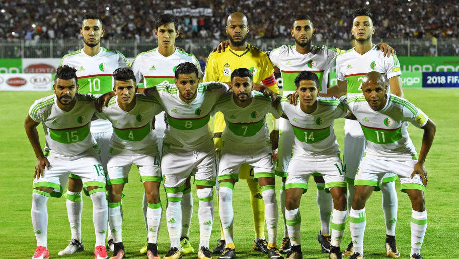 (R-L)-(BOTTOM TO TOP) Algeria's Yacine Brahimi, Abdelraouf Benguit, Riyad Mahrez, Saphir Sliti Taïder, Youcef Attal, Hillel El Arbi Soudani, Ramy Bensebaini, Faouzi Ghoulam, Raïs M'Bolhi Ouhab, NabilNomBentaleb pose for a group photo during the FIFA World Cup qualification football match between Algeria and Zambia at Mohamed-Hamlaoui Stadium in Constantine on September 5, 2017.  / AFP PHOTO / RYAD KRAMDI        (Photo credit should read RYAD KRAMDI/AFP/Getty Images)