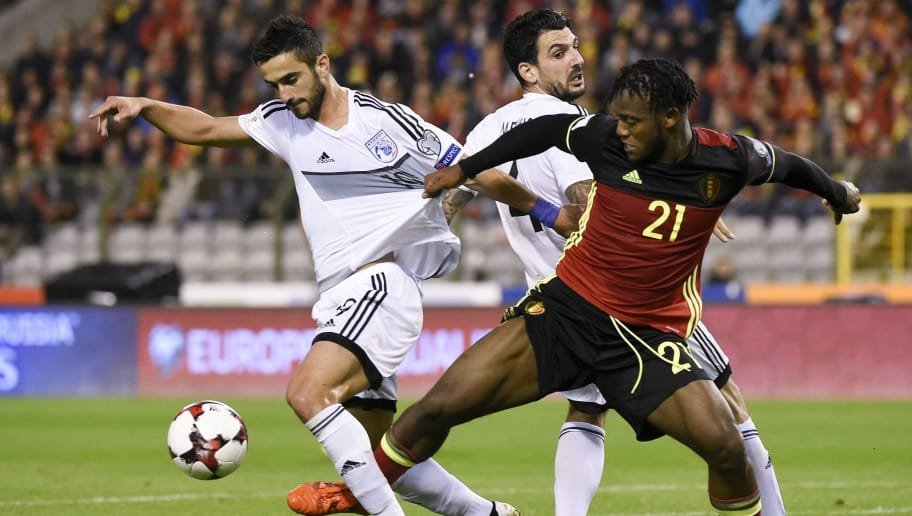 Cyprus' defender Konstantinos Laifis (L) vies with Belgium's forward Michy Batshuayi (R) during the FIFA World Cup 2018 qualification football match between Belgium and Cyprus, at the King Baudouin Stadium, on October 10, 2017 in Brussels. / AFP PHOTO / JOHN THYS        (Photo credit should read JOHN THYS/AFP/Getty Images)