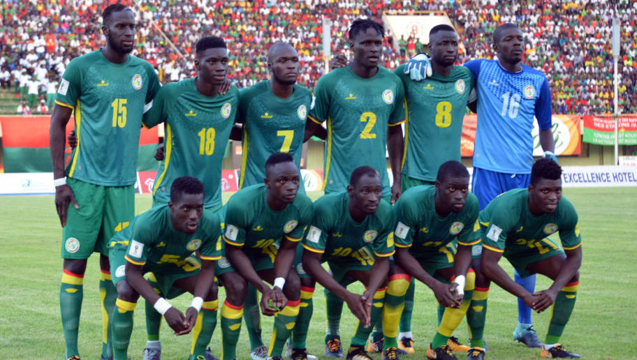 Senegal's team players pose on September 5, 2017 at the stade du 26 aout in Ouagadougou during the World Cup 2018 Africa qualifying football match between Burkina Faso and Senegal.  / AFP PHOTO / Ahmed OUOBA        (Photo credit should read AHMED OUOBA/AFP/Getty Images)