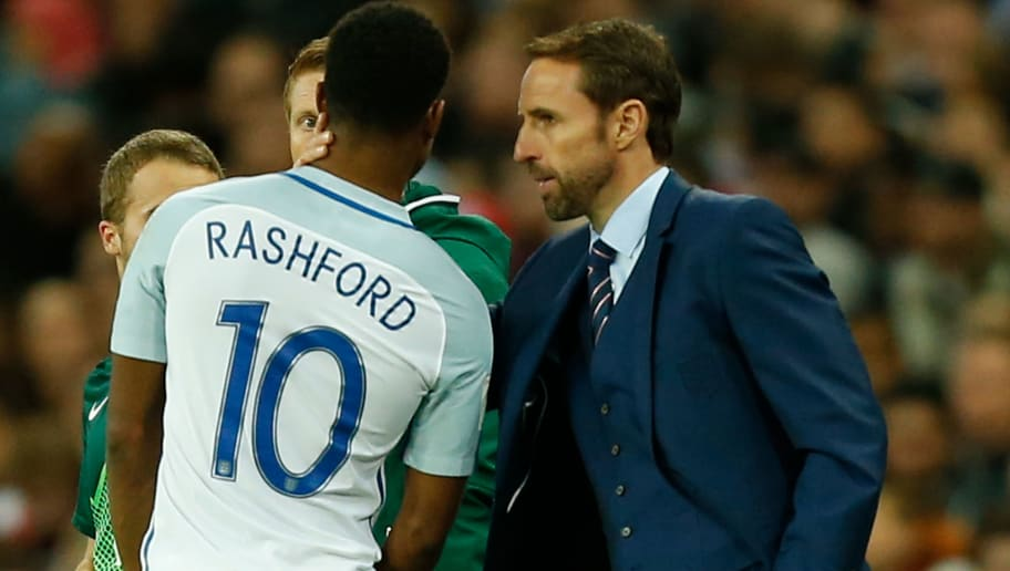 England's manager Gareth Southgate (R) talks with England's striker Marcus Rashford (L) on the touchline during the FIFA World Cup 2018 qualification football match between England and Slovenia at Wembley Stadium in London on October 5, 2017.  / AFP PHOTO / Ian KINGTON / NOT FOR MARKETING OR ADVERTISING USE / RESTRICTED TO EDITORIAL USE        (Photo credit should read IAN KINGTON/AFP/Getty Images)