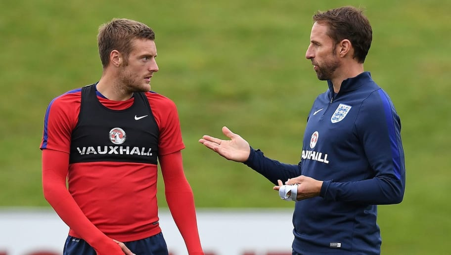 England's striker Jamie Vardy (L) talks with England's manager Gareth Southgate during a training session at St George's Park in Burton-on-Trent on August 29, 2017, as part of an England football team media day ahead of their 2018 FIFA World Cup qualifier matches against Malta on September 1 and Slovakia on September 4. / AFP PHOTO / Paul ELLIS / NOT FOR MARKETING OR ADVERTISING USE / RESTRICTED TO EDITORIAL USE         (Photo credit should read PAUL ELLIS/AFP/Getty Images)