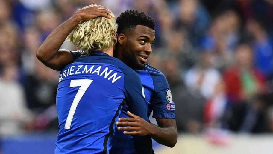 France's midfielder Thomas Lemar (C) celebrates after scoring a goal with France's forward Antoine Griezmann (L) during the 2018 FIFA World Cup qualifying football match France vs Netherlands at the Stade de France in Saint-Denis, north of Paris, on August 31, 2017. / AFP PHOTO / FRANCK FIFE        (Photo credit should read FRANCK FIFE/AFP/Getty Images)