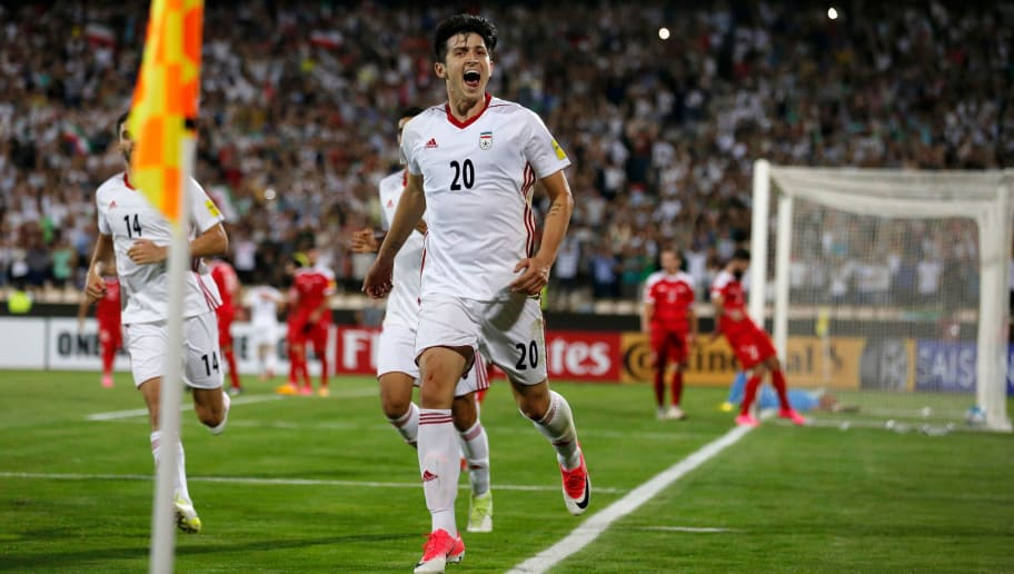 Sardar Azmoun of Iran celebrates after scoring a goal against Syria during the FIFA World Cup 2018 qualification football match between Iran and Syria at the Azadi Stadium in Tehran on September 5, 2017. / AFP PHOTO / ATTA KENARE        (Photo credit should read ATTA KENARE/AFP/Getty Images)