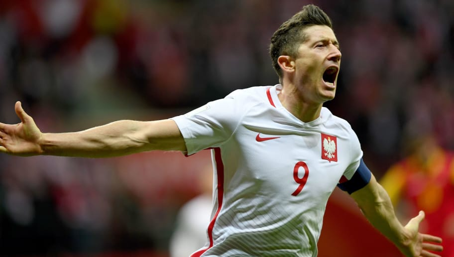 98df02be83c Poland's forward Robert Lewandowski reacts after he scored a goal during  the FIFA World Cup 2018